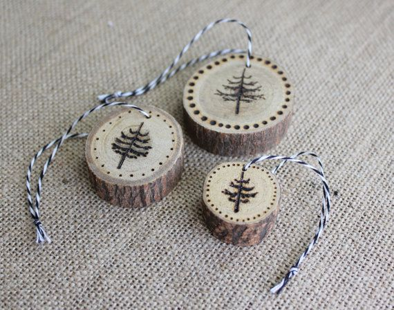 Add a rustic touch to your Christmas tree with this set of tree design wood burned Christmas ornaments.