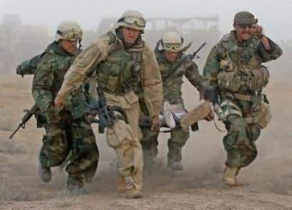 http://historyguy.com/war_in_afghanistan.html  Soldiers carrying a wounded comrade in Afghanistan