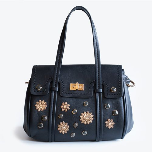 Black field, handbag decorated with woven macrame and little glitter on it. Adadi Accessories