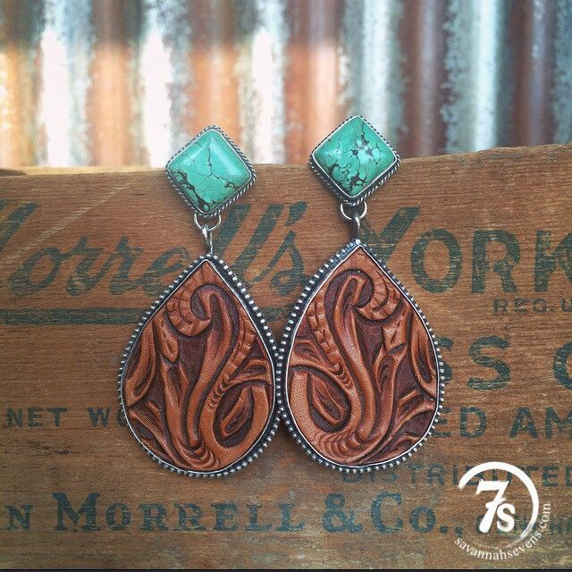 Odessa Earrings - Tooled leather and tuquoise earrings with teardrop detailed hand tooled leather, sterling silver trim and turquoise posts. $299.00