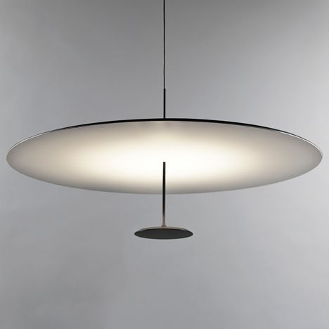 British architecture firm foster partners has created a minimal pendant lamp from two metal discs