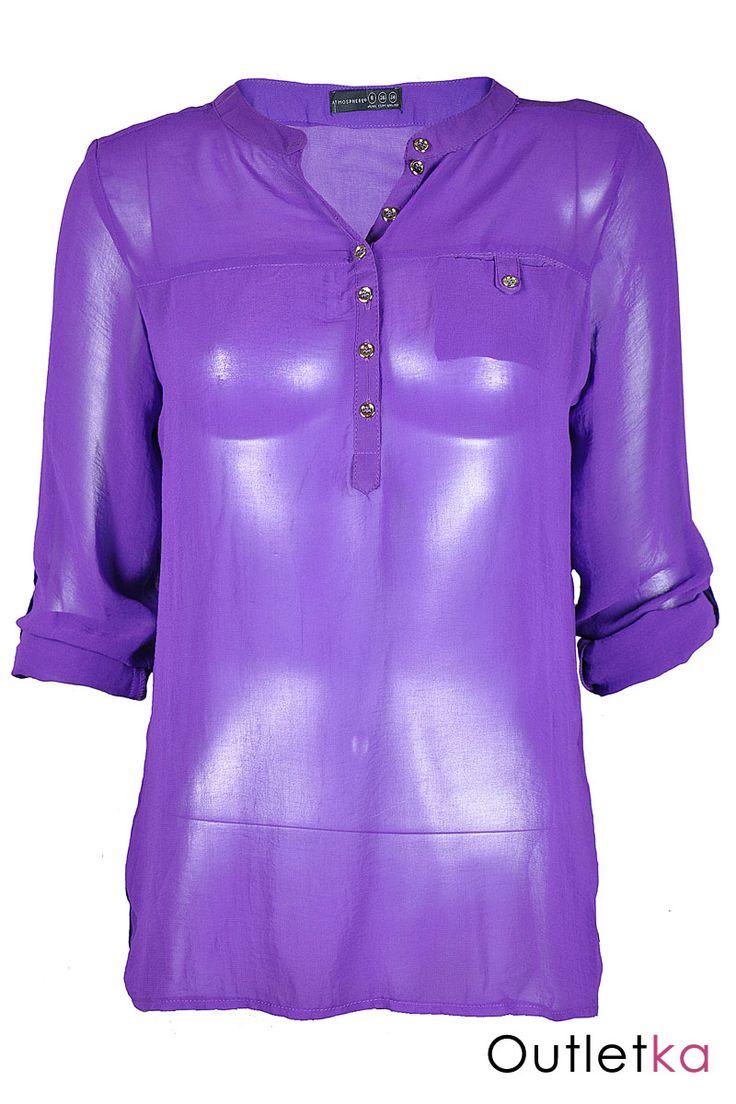 Nowa szyfonowa koszula Atmosphere w odcieniu fioletowym. Koszula gustowna, o ciekawym kroju, na długi rękaw, z możliwością podwinięcia jej do łokcia, z przodu zapinana na guziki do połowy. Posiada kieszonkę co nadaje jej ciekawy i oryginalny wygląd. Rękawy zapinane na guziki. U dołu bluzki małe rozporki/ rozcięcia. Z kompletem firmowych metek Atmosphere.