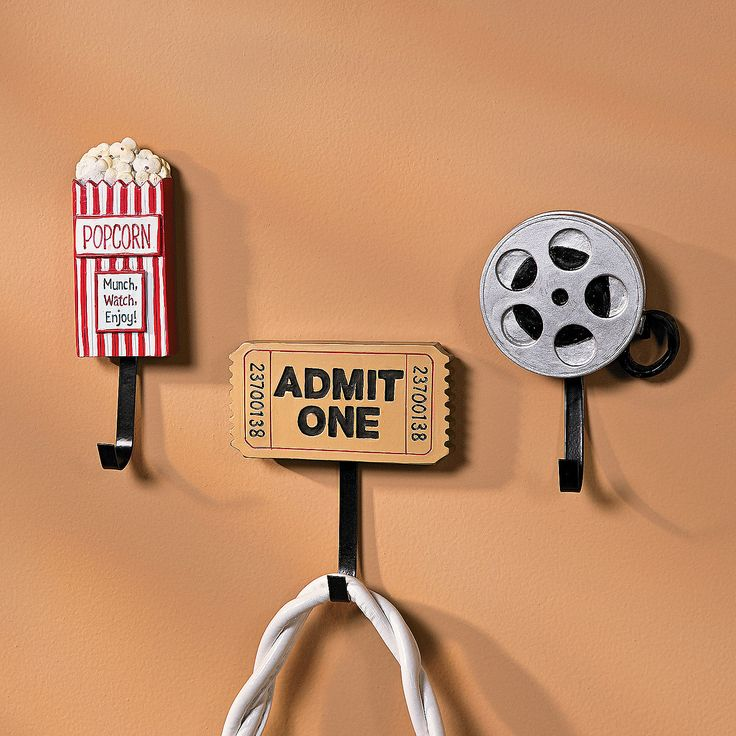 Movie Night Wall Hooks - OrientalTrading.com  I need these to go with all my other movie themed stuff!!