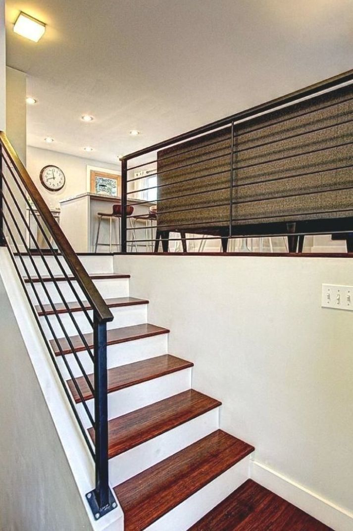 split level living room railing looking for staircase ...