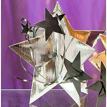 Add shimmer to your tables with this Silver 3-D Star Centerpiece. This 3-D cardboard star centerpiece is 13 inches tall and include smaller stars, curling ribbon and a larger 3-D star.
