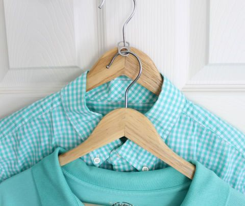 Hooked together with a can tab, two hangers eat up way less closet space. See more at The Shabby Creek Cottage »