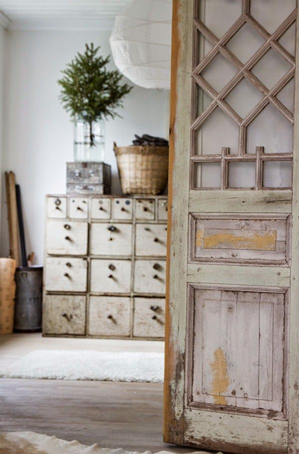 Master bath spin on barn door.       Find out how to make finish look of door.                                   like the brown depth in color and chipping white paint