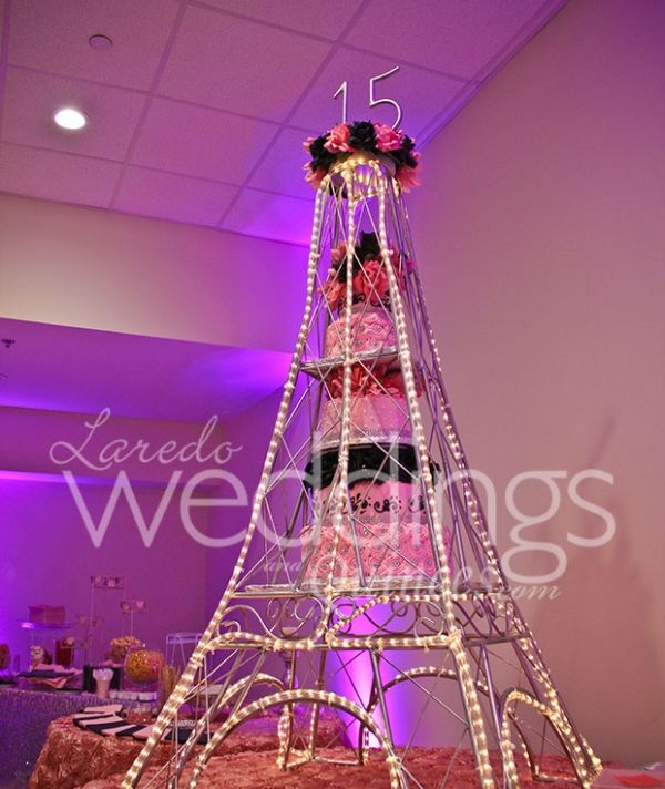 Quinceanera Eiffel Tower Cake In Pink And Black With Natural Flowers