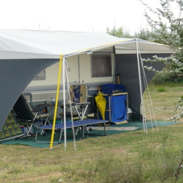 Attaching A Canvas Awning To Your Camper Extends Living Space