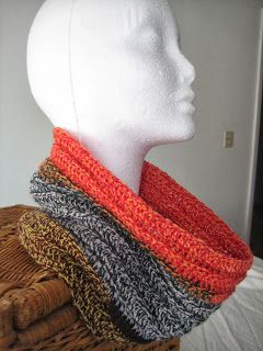 Crazy Cowl Crochet - Chain 101 then  double crochet in the 3rd chain from hook and in each across.  Continue in double crochet for about 18 rows working in the back loop only of each stitch. Finish by single crocheting the two ends together on the wrong side. They can be used as a head stocking too. Use a 5.0mm or H hook