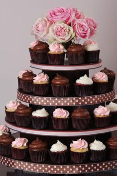 Brown, white and pink cupcake tower. Lovely and luscious.