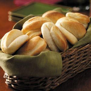 Parker House Rolls Recipe -Mom is especially well-known for the delectable things she bakes, like these moist, golden rolls. When that basket comes around the table, we all automatically take two—one is just never enough. —Sandra Melnychenko, Grandview, Manitoba