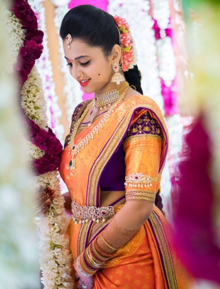 Stunning Bride in Orange Kanjivaram Saree with Purple and Gold Border with Matching Blouse and Diamond Jewelry