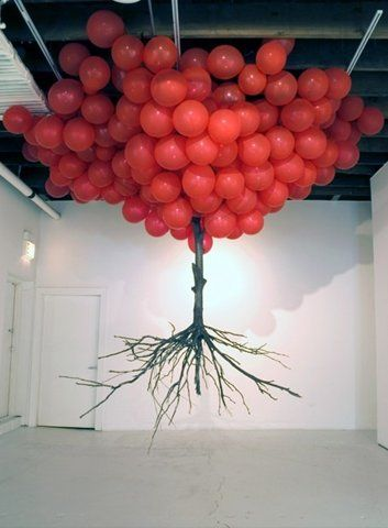 """""""top"""" of the tree is the balloons, then they flipped an actually tree upside down to make it the roots. Creative!"""