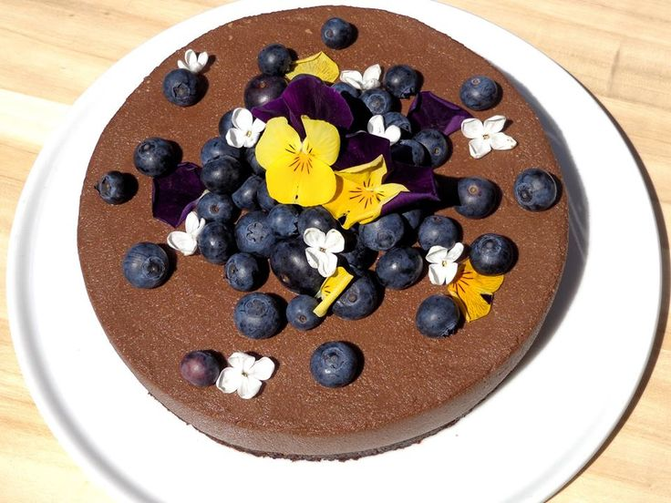 Vegan cake with blueberries and edible flowers- pansy