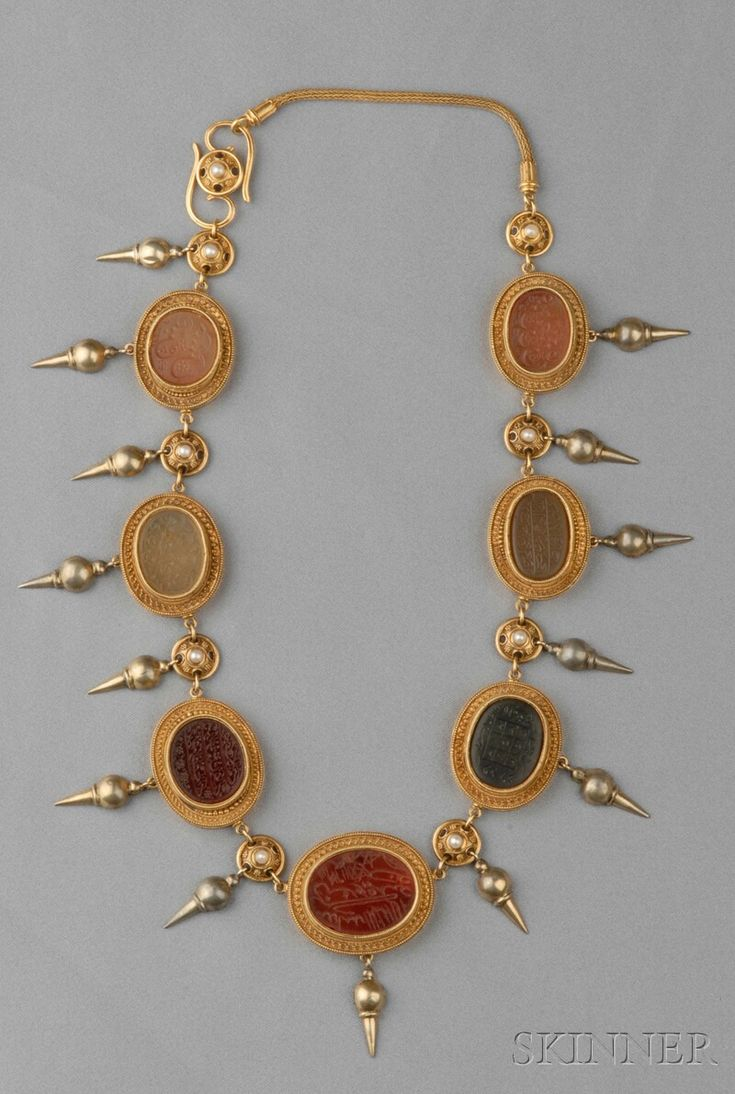 Antique Gold and Hardstone Intaglio Necklace, set with seven intaglios with Islamic script within ropework bezels with applied bead and wire accents, suspending a silver-gilt fringe, and completed by foxtail chain, lg. 18 1/4.