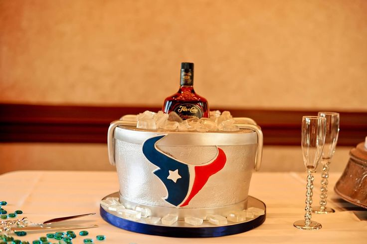 I got my husband the best grooms cake - ever! All of it is real cake except for the bottle of Flur de Cana, a Nicaragua liquor. His mom and Grandma are from Nicaragua and my husband is 1/2 Nicaraguan! And of course he's a HUGE Texans fan!!