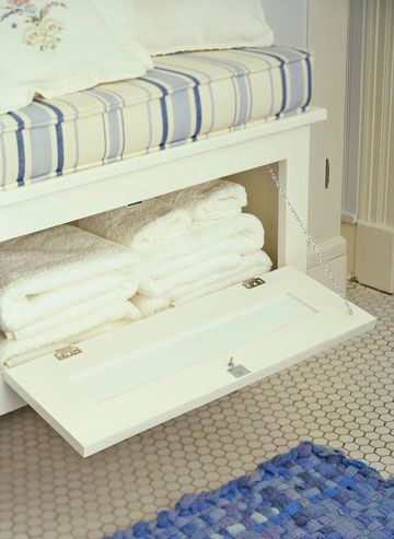 Window Seat Storage - A wall-mount window seat has a second purpose as towel storage. A flip-down door provides easy access. Small toiletries can also be stored beneath the seat. Or remove the cushion and use the seat top to display towels and other bath needs, with less attractive supplies hidden below.