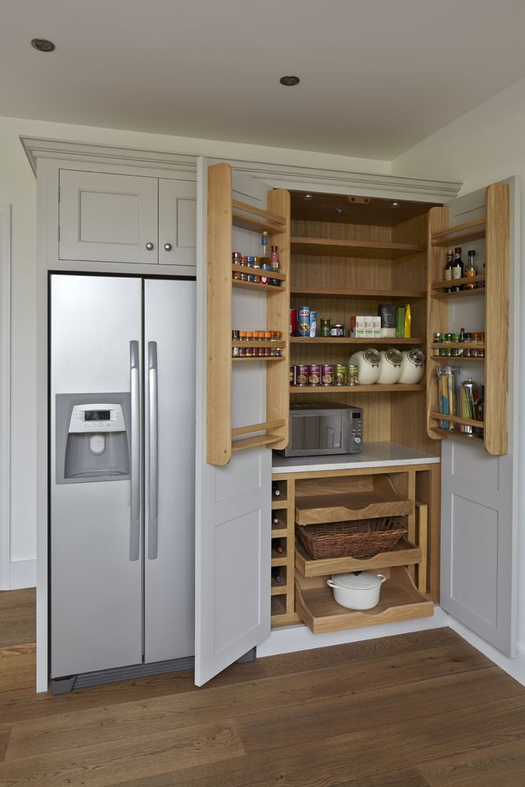 Higham - A large oak larder with scooped and scalloped drawers.