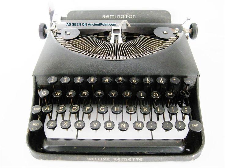Antique 1940s Remington Deluxe Remette Typewriter Art Deco White On Black Keys Typewriters photo