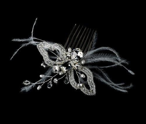 """WHITE Crystal & Feather Pearl Butterfly Wing Bridal Hair Comb  Simply gorgeous, this elegant butterfly wing bridal hair comb features stunning components of white feathers, pearls, rhinestones, and genuine Swarovski Crystal accents. Because of the variety of elements showcased in this hair piece, it will coordinate with a large assortment of detailing in dress attire.Size: Comb Measures 3-1/2 Wide x 2"""" High """""""