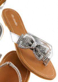 Make a great fashion statement this coming season with these lovely sandals! This is a great shoe for your destination wedding or even as your reception dancing shoes!  Flip flop features stylish a bow that is embellished with flatback crystals.  Fully lined. Imported.  The sole has a natural color variation within each shoe.