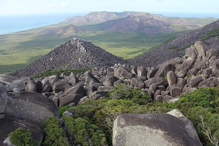 Melville Range, Australia  In 2013, scientists discovered this remote rainforest in Australia. It is located on a giant boulder plateau on Cape York Peninsula, and is only accessible by helicopter.