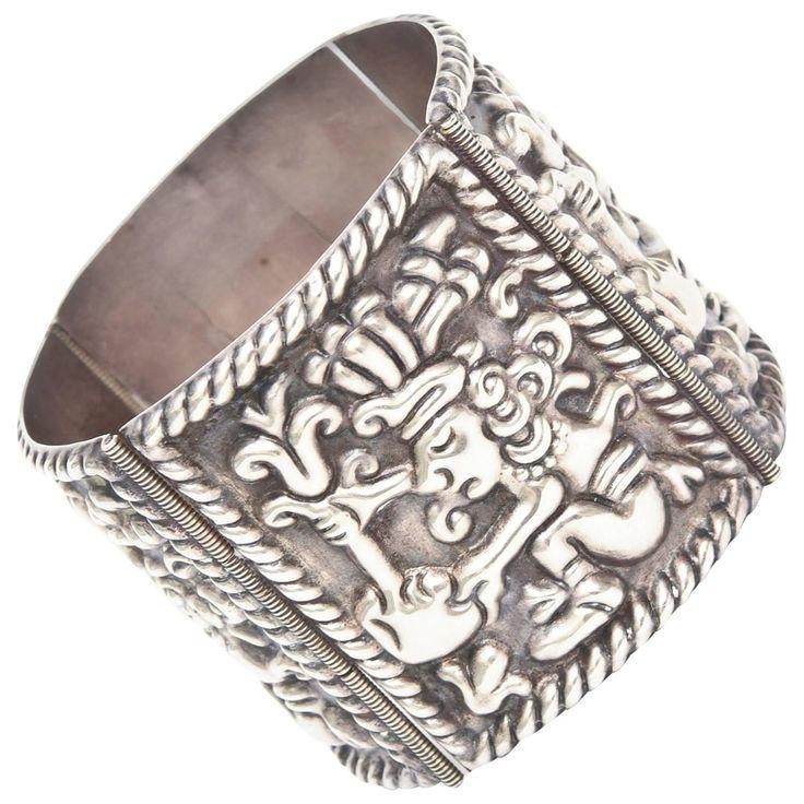Sterling Silver Aztec Mayan Cuff Bracelet  | From a unique collection of vintage cuff bracelets at https://www.1stdibs.com/jewelry/bracelets/cuff-bracelets/