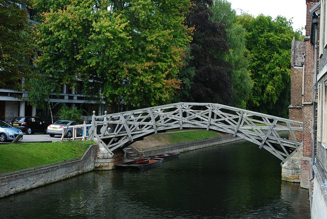 The Mathematical Bridge is the popular name of a wooden footbridge across the River Cam, between two parts of Queens' College, Cambridge. Its official name is simply the Wooden Bridge.