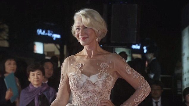 Helen Mirren, 70, shows off her incredible figure as she twirls on the red carpet in fairytale gown at the opening ceremony for the Tokyo International Film Festival.