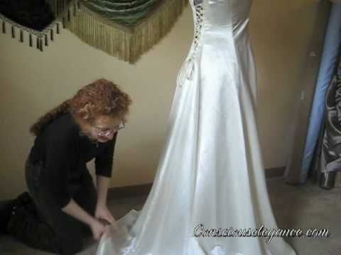 How to bustle a dress....from actually creating the bustle points, what to use to secure the bustle points together, to how to bustle it into place.  LOVE this one!