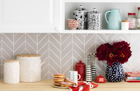 Love this Herringbone pattern kitchen backsplash! HGTV Magazine