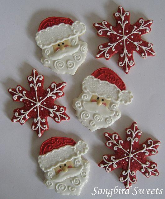 Santa Faces & Snowflakes --love the red snowflakes! #holidaycookies #cookiedecorating