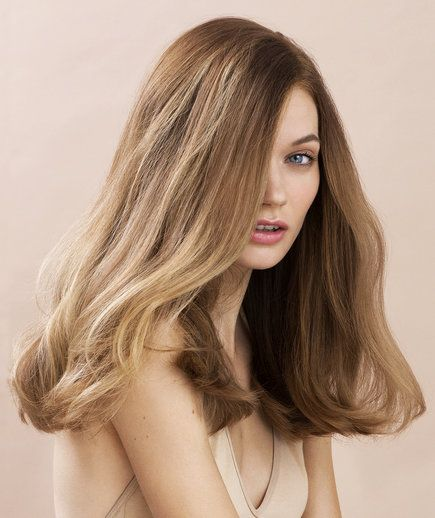 Model with thick dark blonde hair | Different folks need different strokes: A customized guide for women with thick, coarse hair.