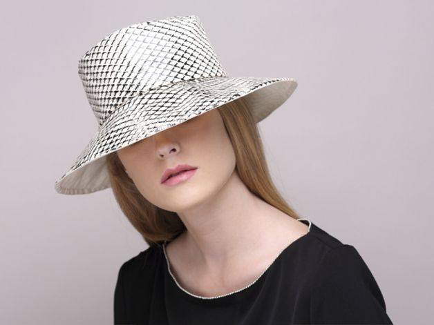 "This unique wide brim hat is laminated with a patterned foil which makes the hat waterproof.  A perfect rain hat for men & women.  Materials: cotton Dimensions: 3 "" brim, approximately  The hat..."