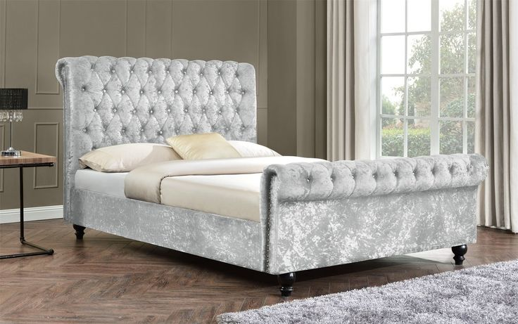 Tyrell Upholstered Bed Frame. Luxurious upholstered chesterfield fabric bed frame. This is a fantastic contemporary diamond shape design fabric bed frame and comes in high quality crushed velvet fabric. The high quality fabric is detailed with diamante crystals on the headboard and footboard.