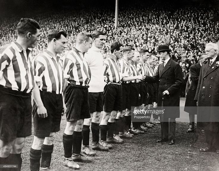 The Prince of Wales, later King George VI, greets the Sheffield United football team prior to the FA Cup Final between Cardiff City and Sheffield United at Wembley Stadium in London on 25th April 1925. Sheffield United won 1-0.