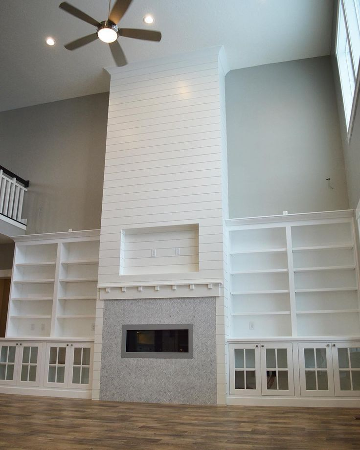 Dining room fireplace, stone and shiplap with built ins ...