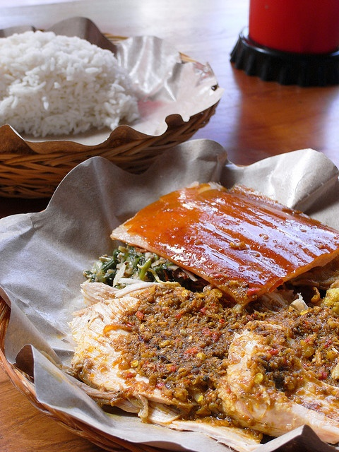 On his visit to Bali, Anthony Bourdain declared the babi guling (suckling pig) served at Ibu Oka, in Ubud, the best that he's ever had. Generous chunks of tender roasted pork served with thick, crispy skin. The Nasi Babi Guling special is served with a fiery red sauce over local greens, cooked jackfruit and coconut-infused rice. Each pig is stuffed with a secret blend of Balinese spices and spit-roasted over an open fire for about five hours while basted with coconut milk. All for about £2.