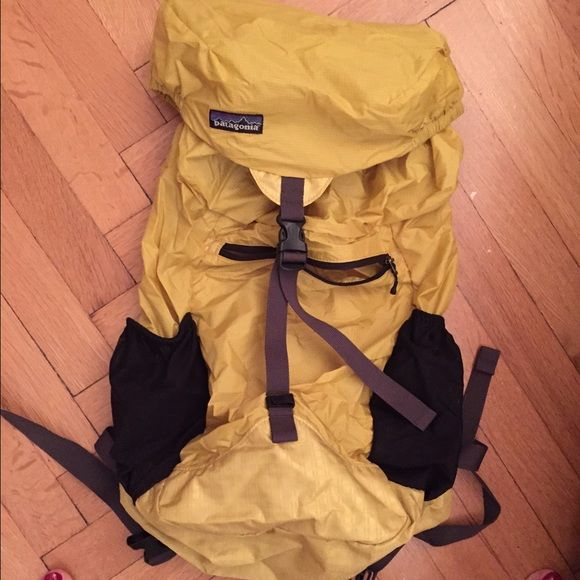 Patagonia backpack - great for travel! Yellow Patagonia byline backpack. Super light, great for travel, folds into itself and zips away. Smoke- and pet-free home. Patagonia Bags Backpacks