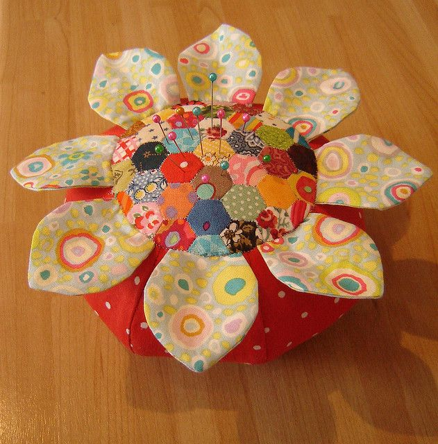 Pincushion with tiny hand stitched patchwork by duniris. Pincushion made with Anna Maria Horner pattern.