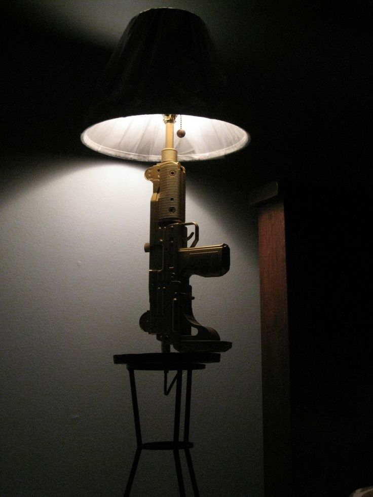 man   cave  gun lamps | Via Cory Villano