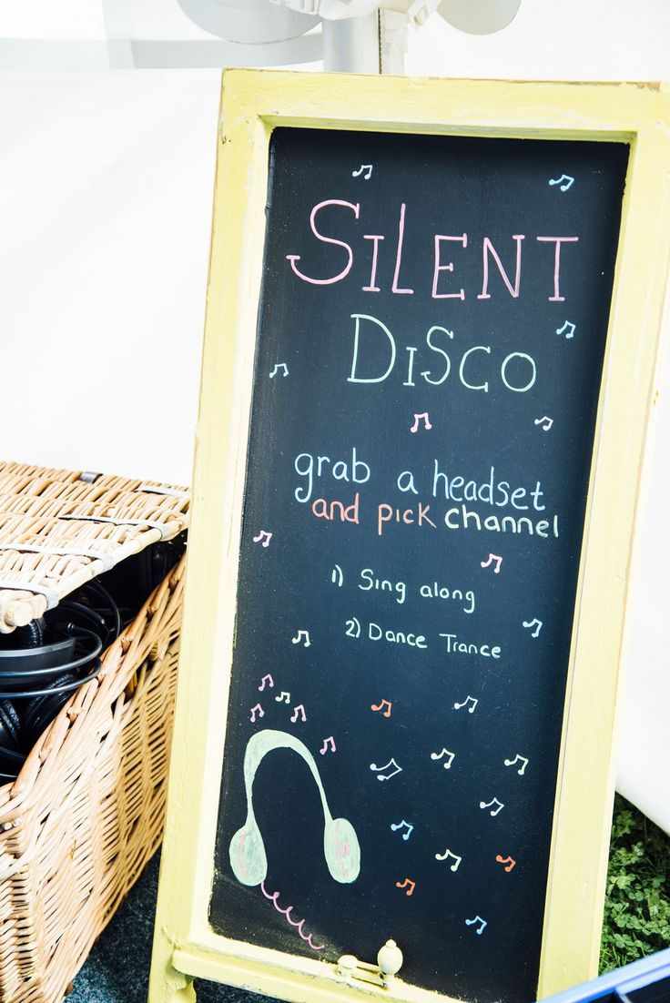 FESTIVAL BRIDES   A Festival Inspired Colourful Outdoor Wedding with Glamping - silent disco wedding signage