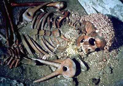 Burial of boy at Arene Candide, Liguria. Upper Palaeolithic/Gravettian (23500 BP). Included hundreds of shells as cap, grave goods (shells, mammoth ivory, elk antler, flint blade). Cave later reused, site of transfer of Neolithic into Corsica, Sardinia.