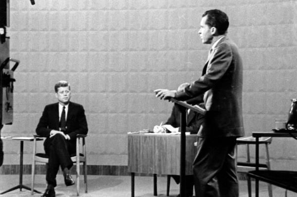 On Sept. 26, 1960, the first televised presidential debate aired from a Chicago TV studio. It featured candidates John F. Kennedy and…