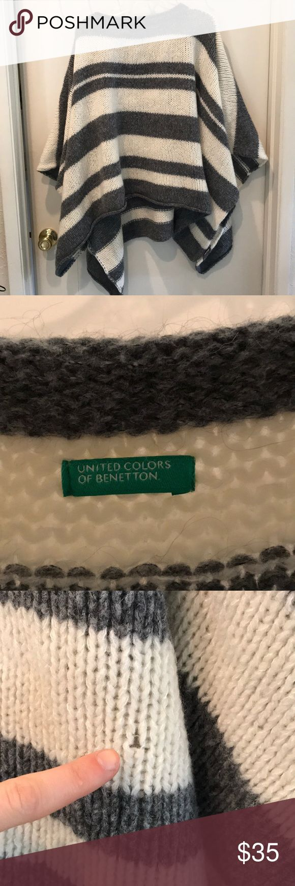United colors of Benetton poncho One size fits all United colors of Benetton brand. Grey and white stripped poncho. One minor hole as seen in pic! Super warm and cozy! Great to throw over to make an outfit look put together United Colors Of Benetton Sweaters Shrugs & Ponchos