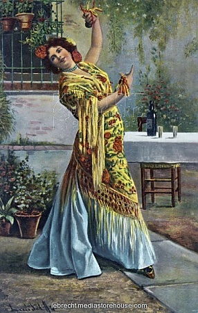 Spanish flamenco dancer dancing  Spanish flamenco dancer dancing and playing the castanets. Flowers in her hair.. Stunning Photo Gifts From Lebrecht Music & Arts