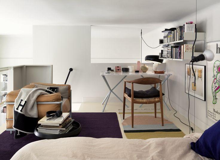 Bedroom on a loft with storage and bookshelfs