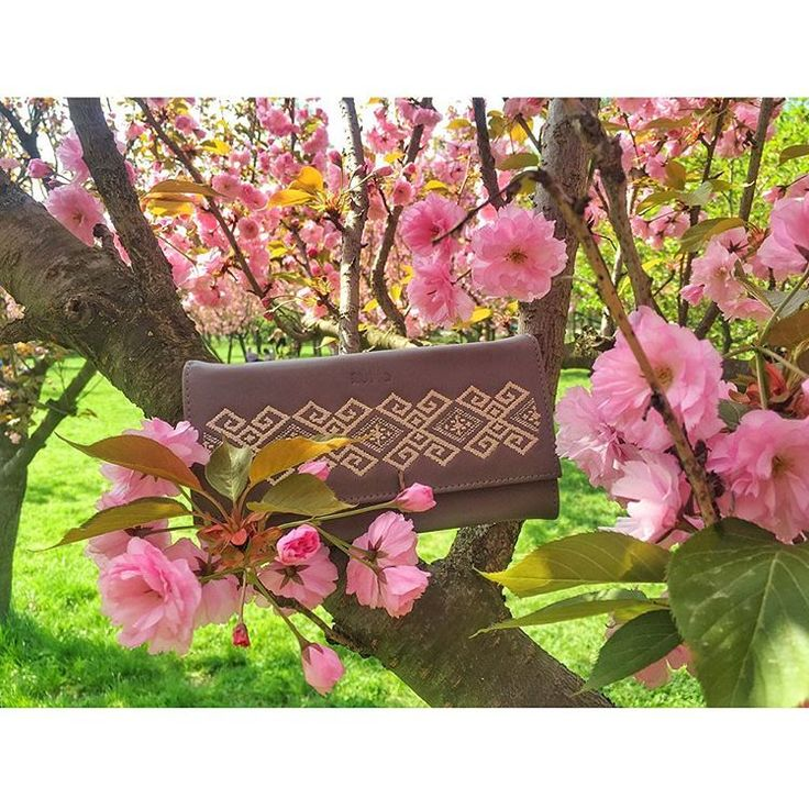 Spring is here and our lovely Carla Truica went for a walk in the park.  #joyofwearingiutta #wallet #grey #iutta #embroidery #spring #walk