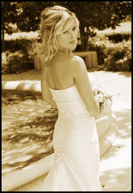 Wedding Hair Updos for long, curly hair with flower | wedding hairstyle pictures with half updo and medium curly hair.jpg